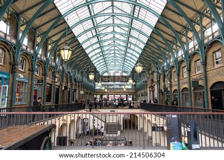 LONDON - UK -  JUNE 22, 2014: View of Covent Garden market in London. Covent Garden - one of the main tourist attractions in London - is known for its restaurants, pubs, market stalls and shops - stock photo