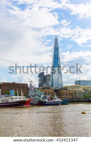 London, UK - June 15, 2016: view over river Thames to The Shard. The Shard is with 310 meters the second largest building in Europe.