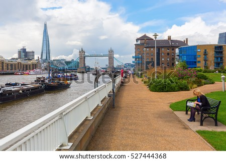 London, UK - June 15, 2016: view over the Thames in London, with unidentified people. London is the capital of England and one of the most important cultural, finance and trade cities of the world