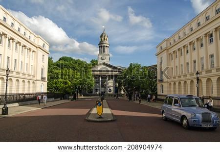 LONDON, UK - JUNE 7, 2014: York Gate near Regent's Park with the parish church of St Marylebone.  The Georgian church was where literary figures Robert Browning and Elizabeth Barrett were married. - stock photo