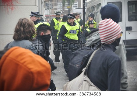 LONDON, UK - MAR 26, 2011: Riot police deploy in the city center after violent riots break out during a 250,000 strong TUC organised anti public sector spending cuts rally. - stock photo