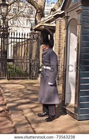 LONDON, UK - MARCH 19: A Soldier stands guard by the sentry box,outside the Royal residence of The Prince of Wales at Clarence House. March 19, 2011 in London UK. - stock photo