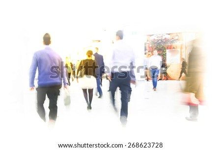 LONDON, UK - MARCH 31, 2015: Business people moving blur. People walking in rush hour. Business and modern life concept - stock photo