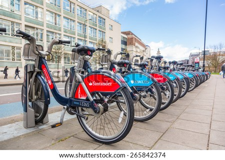 LONDON, UK - MARCH 31, 2015: Cycle hire docking station with new bikes sponsored by Santander who replaced Barclays as main sponsor.