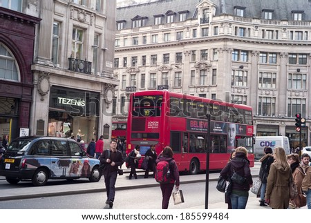 London UK� March 27, 2014: Daily lifestyle in big city taken at Oxford Street London, England. - stock photo
