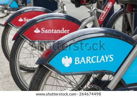 LONDON, UK - MARCH 28: Detail of Boris bikes in line. March 28, 2015 in London. On 27 February 2015. Mayor Boris Johnson secured Santander's sponsorship on the bike's scheme to replace Barclays bank.. - stock photo