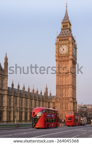 LONDON, UK - MARCH 14, 2015: Double-deck red buses on Westminster Bridge with Big Ben in London, England, United Kingdom