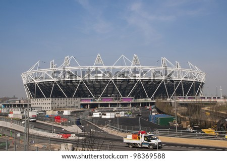 LONDON, UK - MARCH 24: London Olympics Stadium with its construction site on March 24, 2012 in London. The Olympic Park is due to be ready in summer for the games. - stock photo