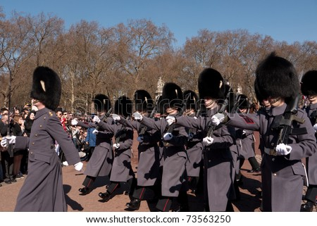 LONDON, UK - MARCH 19: Members of the company of the Grenadier Guards Marching into Buckingham Palace during the Changing of the Guard Ceremony. March 19, 2011 in London UK. - stock photo