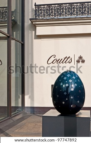 LONDON,UK-MARCH 11: One of Faberge's Big Egg Hunt eggs embossed in sliver by UK luxury jeweller of the year David Marshall, sponsored by Coutts in the Strand. March 11, 2012 in London UK - stock photo