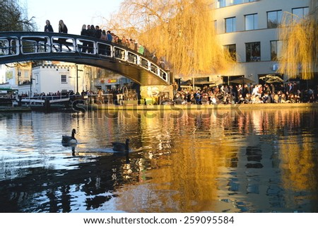 LONDON, UK-MARCH 07, 2015: People enjoy day out  in Camden Town, London. Famous tourists destination which attract tens thousands people every day offering food, shops, sightseeing by boat, walk. - stock photo