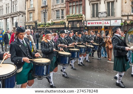London, UK - March 13, 2011: People watching drummers in Saint Patrick parade in trafalgar london - stock photo