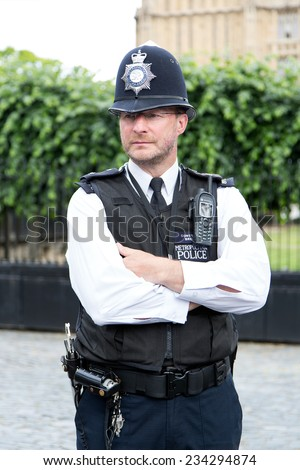 London, UK March 28 2014: portrait of British police near the House of Parliament located in north end of the Palace of Westminster in London - stock photo
