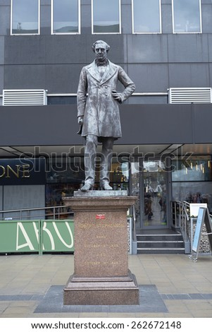 LONDON, UK - MARCH 21: Statue of railway engineer Robert Stephenson at Euston Station. March 21, 2015 in London. Stephenson is considered to be the greatest engineer of the 10th century. - stock photo