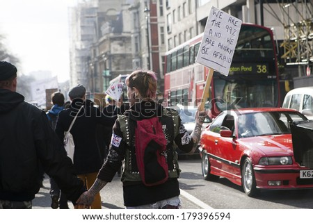 LONDON, UK - MARCH 1TH 2014. London protesters march against worldwide government corruption. In London on 1th March 2014. - stock photo