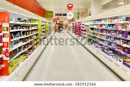 London, UK - March 7, 2015: View of an empty aisle at a Sainsbury's supermarket. Sainsbury's is the UK's second largest supermarket retailer second to Tesco with a revenue of £23 billion in 2013.