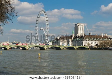LONDON UK - MARCH 22, 2016:View of London Eye over Lambeth Bridge across River Thames. Since January 2015 it has been known as the Coca-Cola London Eye, following an agreement signed in September 2014