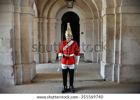 LONDON, UK - MAY 30, 2015: A member of the Horse Guard stands guard at Horse Guard Parade in Westminster. - stock photo