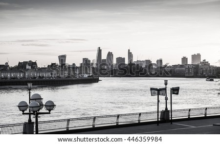 London, UK - May 21, 2015: City of London view at dusk. Modern business and banking aria with first night lights and River Thames  - stock photo