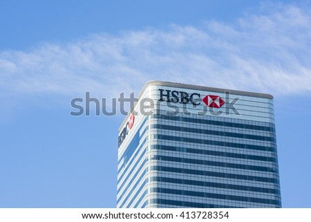 LONDON, UK - MAY 1, 2016: Cropped shot of Canary Wharf HSBC bank skyscraper against blue sky. Canary Wharf is London's second financial district. - stock photo