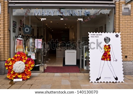 LONDON, UK-MAY 26: Fashion designer Mary Quant's store decorated for the Chelsea Fringe, celebrating 100 years of the RHS Chelsea Flower Show. May 26, 2013 in London UK. - stock photo