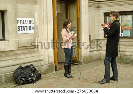 LONDON, UK - MAY 7, 2015:  Journalists from M4N reporting from outside a Polling Station in Westminster during the UK General Election. - stock photo