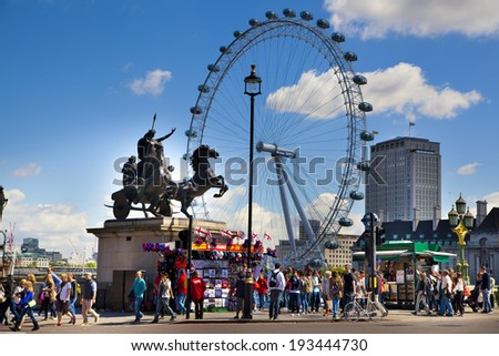 LONDON, UK - MAY 14, 2014  -  London eye is a giant Ferris wheel opened on 31 December 1999, the most famous tourist s attraction in centre London - stock photo