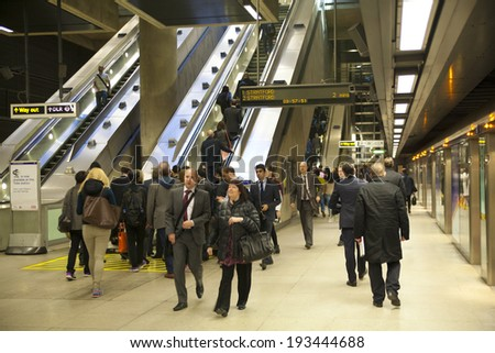 LONDON, UK - MAY 14, 2014: London tube, Canary Wharf station, busiest station in London, bringing about 100 000 office workers every day  - stock photo