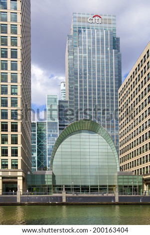 LONDON, UK - MAY 14, 2014: Modern glass architecture of Canary Wharf aria the leading centre of global finance, banking, media, insurance etc. Office buildings