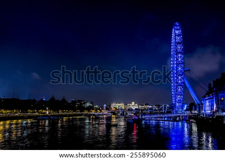 LONDON, UK - MAY 29, 2013: Night shot of London Eye. London Eye (135 m tall, diameter of 120 m) - a famous tourist attraction over river Thames in the capital city London. - stock photo