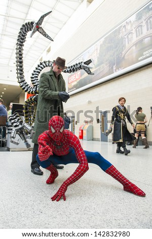 LONDON, UK - May 26: Spiderman and Doctor Octopus cosplayers posing at the MCMExpo at the Excel Centre. May 26, 2013 in London. - stock photo