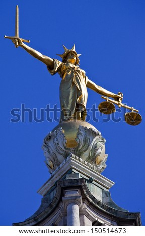 LONDON, UK � MAY 1ST 2013: The magnificent Lady Justice statue ontop of the Old Bailey (Central Criminal Court of England and Wales) in London.