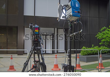 LONDON, UK - MAY 7, 2015:  Television broadcasting equipment outside the entrance to the Labour Party's headquarters in Westminster, London on the day of the general election. - stock photo