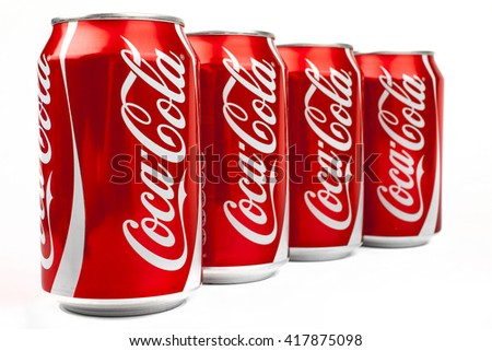 LONDON, UK - MAY 6TH 2016: Cans of Coca Cola drink isolated over a plain white background, on 6th May 2016.  The drink is produced and manufactured by The Coca-Cola Company.