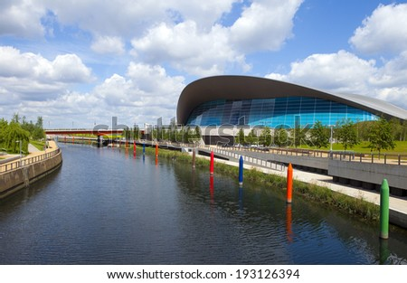 LONDON, UK - MAY 15TH 2014: The impressive Aquatics Centre located in the Queen Elizabeth Olympic Park beside the Waterworks River in Stratford, London on 15th May 2014. - stock photo