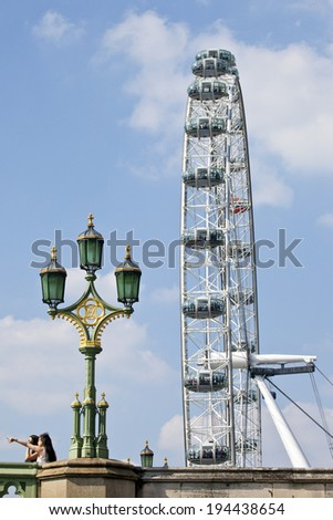 LONDON, UK - MAY 18TH 2014: The London Eye viewed from the Albert Embankment in London. - stock photo