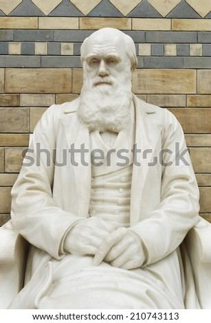 LONDON, UK - MAY 31, 2014: The Statue of Charles Darwin in the Natural History Museum, the statue was moved into its new position at the top of the main staircase in the Central Hall in May 2008.