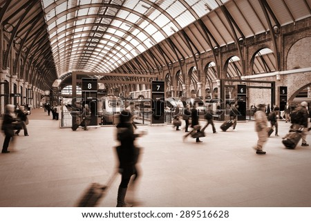 LONDON, UK - MAY 15, 2012: Travelers hurry at King's Cross train station in London. With 26 million annual travelers (2011-12) it is one of the busiest stations in the UK. - stock photo