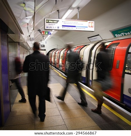 LONDON, UK - MAY 15, 2012: Travelers hurry at King's Cross underground station in London. London Underground is the 11th busiest metro system worldwide with 1.1 billion annual rides.