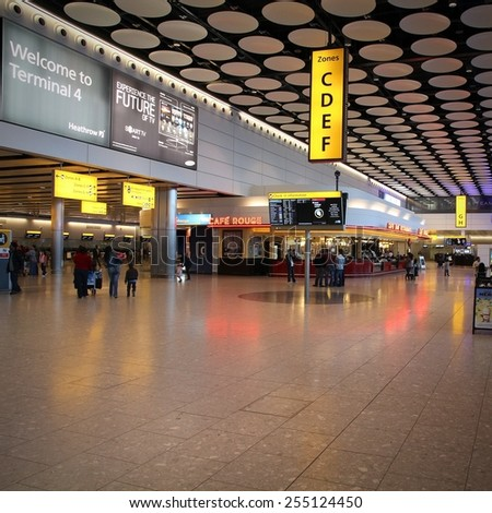 LONDON, UK - MAY 13, 2012: Travelers visit Heathrow airport in London. Heathrow has been world's busiest airports by international passenger traffic since 2000 (64.7 million in 2011). - stock photo