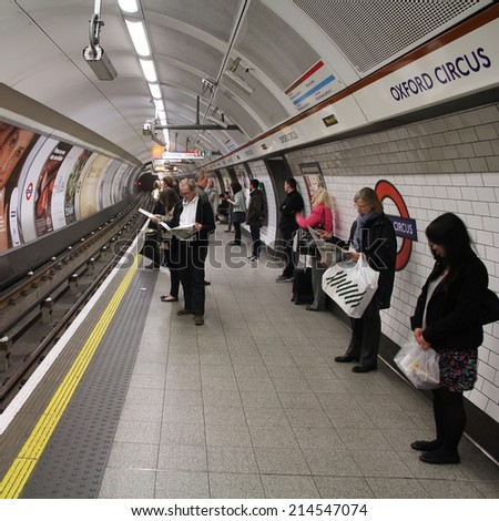 LONDON, UK - MAY 14, 2012: Travelers wait at Oxford Circus underground station on May 14, 2012 in London. London Underground is the 11th busiest metro system worldwide with 1.1 billion annual rides.