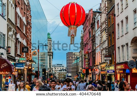 LONDON, UK - MAY 30 2013: View of Chinatown in London. Chinatown is part of Soho area of City of Westminster. It contains a number of Chinese restaurants, bakeries, souvenir, shops and other. - stock photo