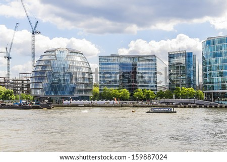 LONDON, UK - MAY 25, 2013: View of London City Hall Building (designed by Norman Foster, 2002) from the river Thames. City Hall is considered a green building with solar panels.