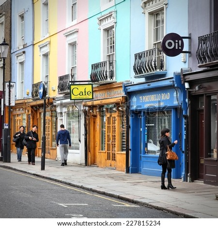 LONDON, UK - MAY 14, 2012: Visitor watches shop windows in Notting Hill, London. Portobello Road Market at Notting Hill currently is one of top 15 shopping destinations in London. - stock photo