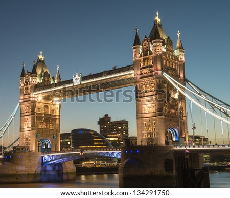 London, UK. Night view of famous Tower Bridge and Thames river. - stock photo
