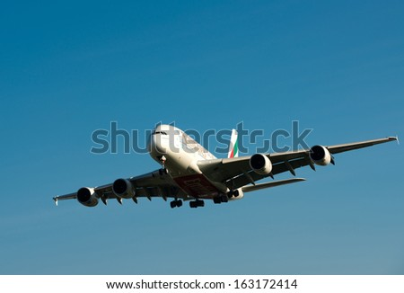 LONDON, UK - NOV 16: A Emirates  aircraft approaching Heathrow airport on Nov 16, 2013 in London, UK  ,Airbus A380 is the world's biggest jet airliner - stock photo