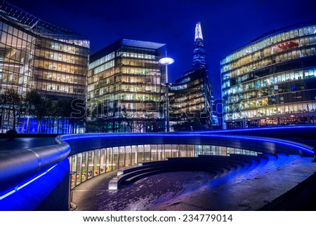 LONDON, UK - NOV 18 2014: A night-time panoramic view of the 'The Scoop' - an outdoor amphitheatre in London. The Shard can also be seen. - stock photo