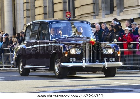 LONDON, UK - NOV 10: Catherine, Duchess of Cambridge together with Prince William being driven back to Buckingham Palace after the Remembrance Sunday service on Nov 10, 2013 in London UK. - stock photo