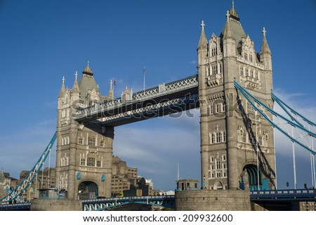 LONDON, UK - NOV 6: Tower Bridge on November 6, 2013 in London, UK. Tower Bridge, built from 1886-1894, is a combined bascule and suspension bridge in London which crosses the River Thames. - stock photo
