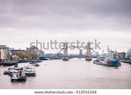LONDON UK - NOVEMBER 10, 2015. Belfast ship and Tower bridge on the River Thames in early morning time